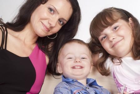 mum, brother, sister smiling